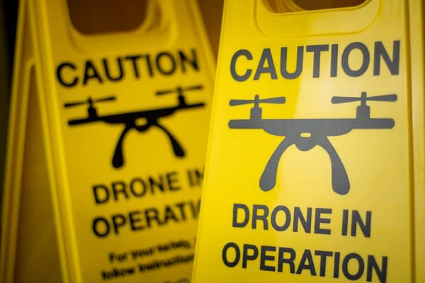 Folding Yellow Drone Safety Sign