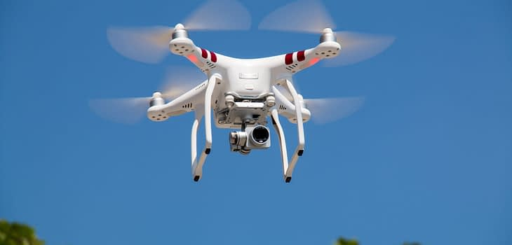 drone flying against blue sky