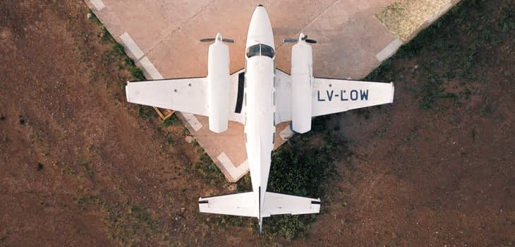 light aircraft on edge of helipad